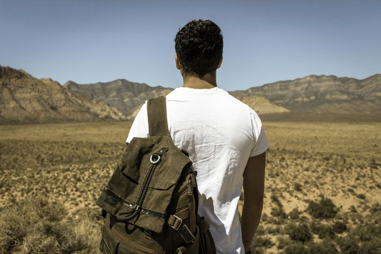 Photo of a person of color with a backpack